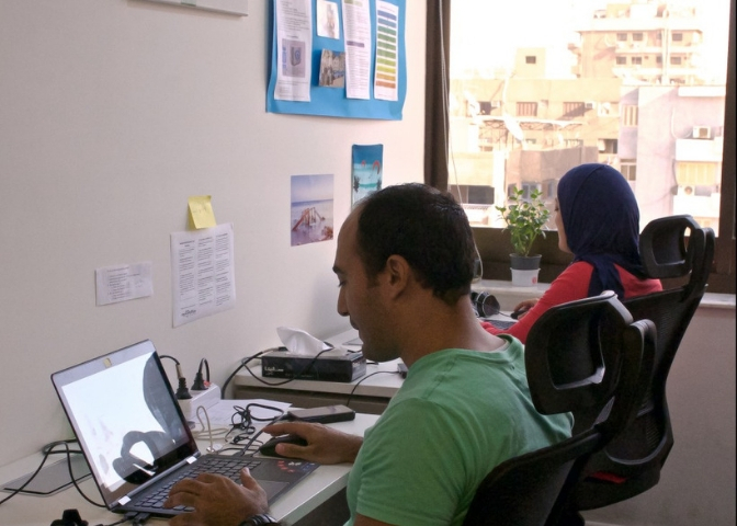 Two professionals working in myCOoffice private office in Heliopolis
